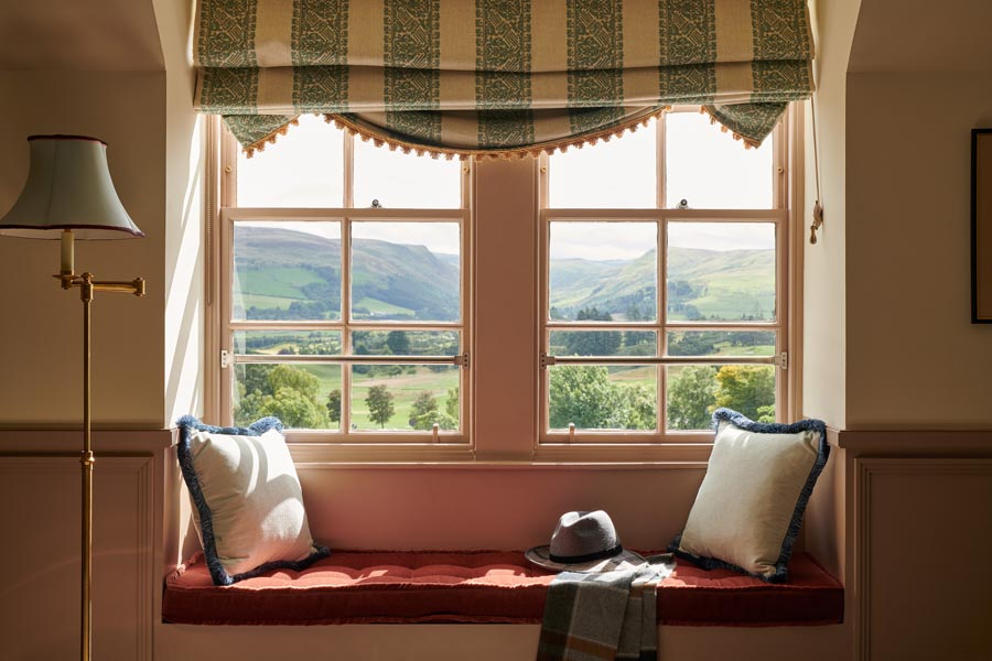 A bay window seating area looking out over the Ochil hills in a Two bedroom whisky suite at Gleneagles