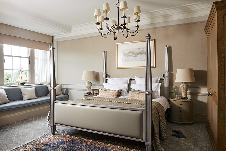 A grey king sized four poster bed