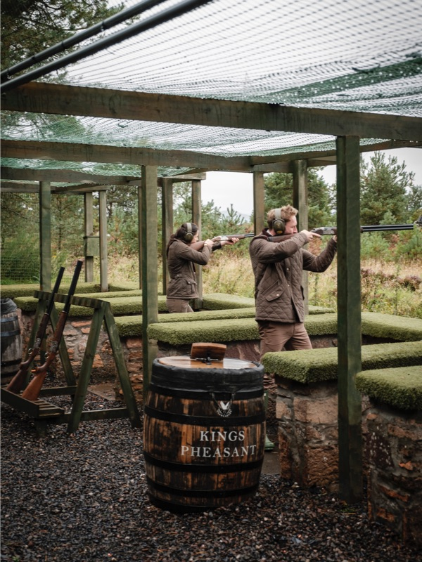 A couple shoot clays from a range at Gleneagles
