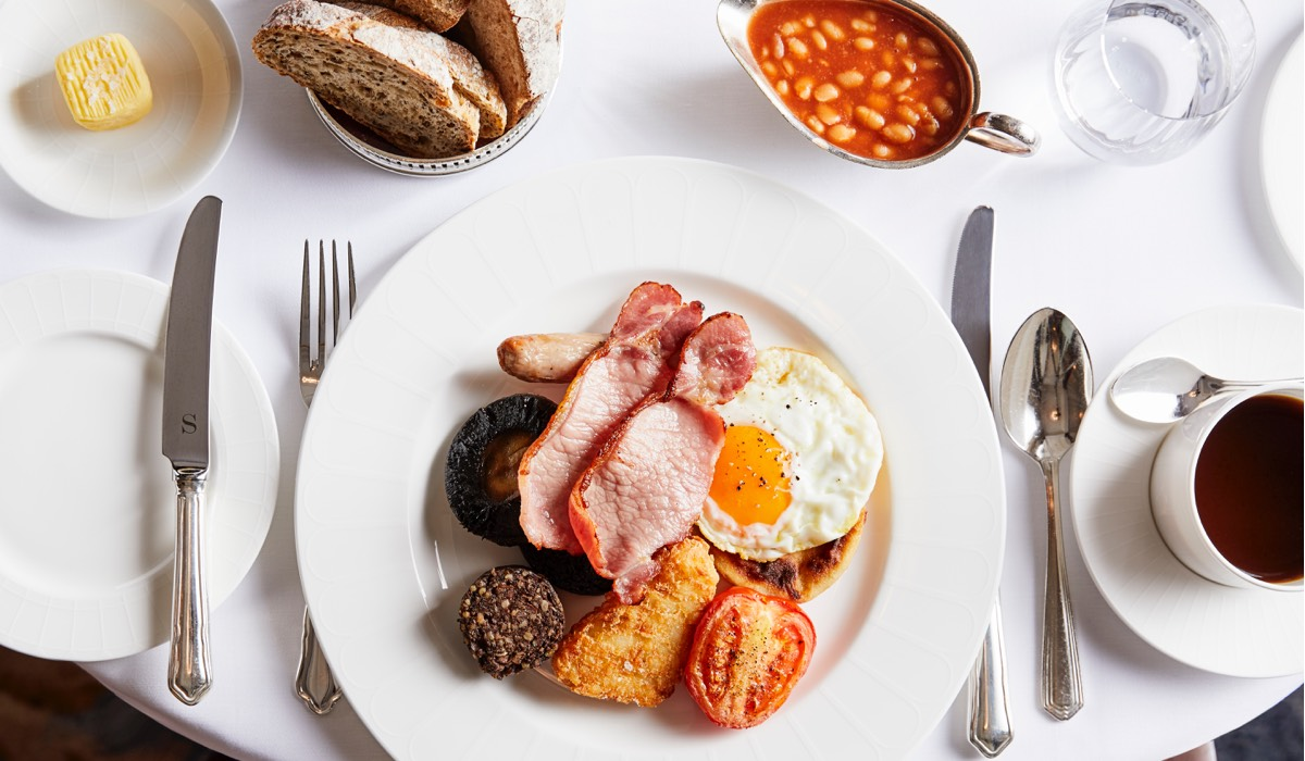 A full Scottish breakfast with side of beans and toast and a black coffee in The Strathearn