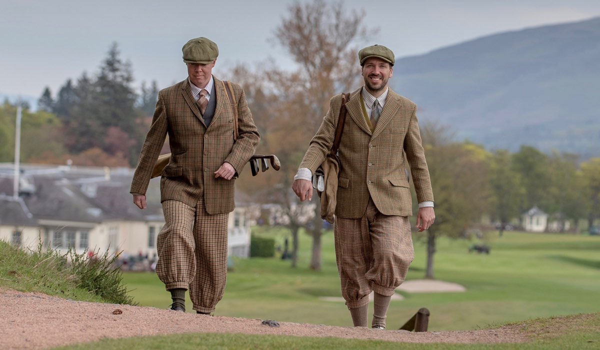 Two Gleneagles staff dressed in vintage golf attire