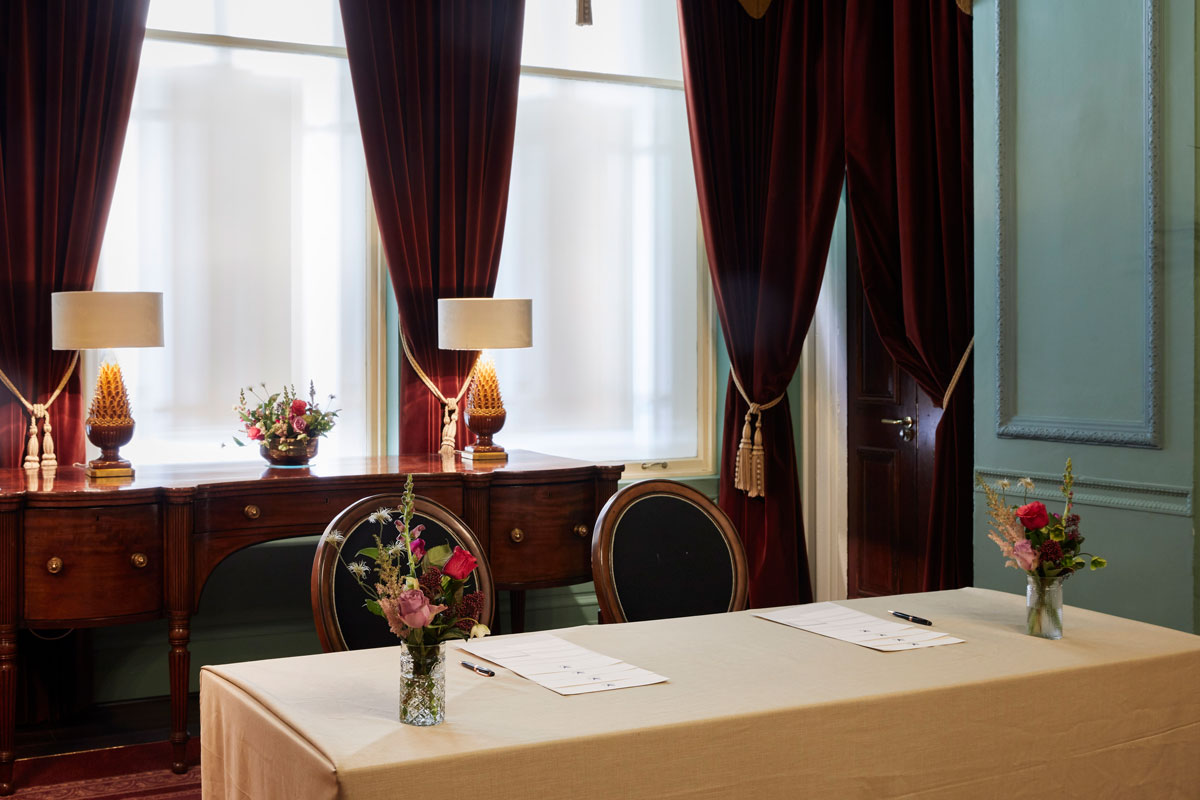 A table set up for a private checkin in the parlour room