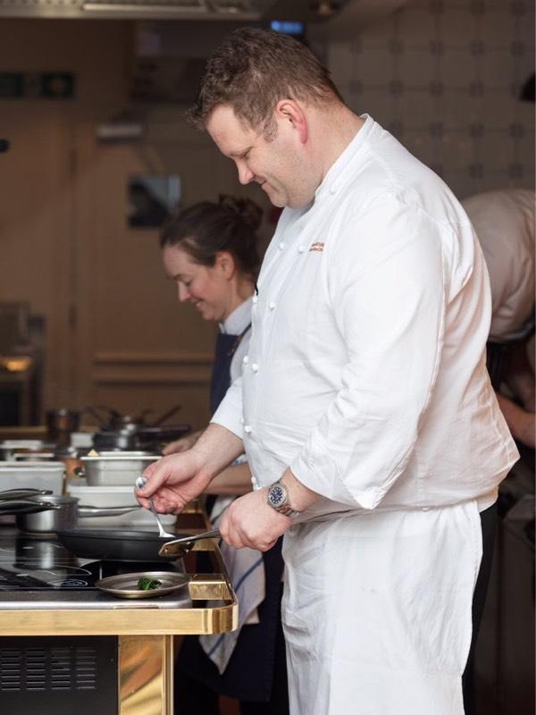 Simon attridge cooks in a kitchen