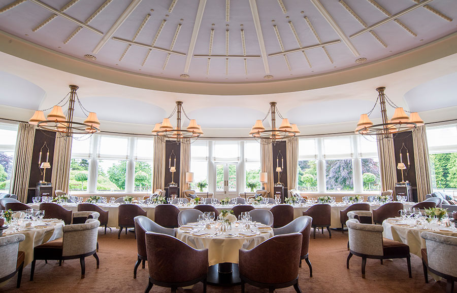 Tables of five set for a private dinner with Windows overlooking the lawn at Gleneagles