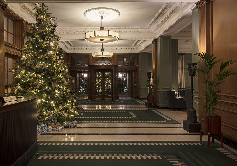 The lobby at Gleneagles decorated for Christmas with a large tree outside the Century Bar