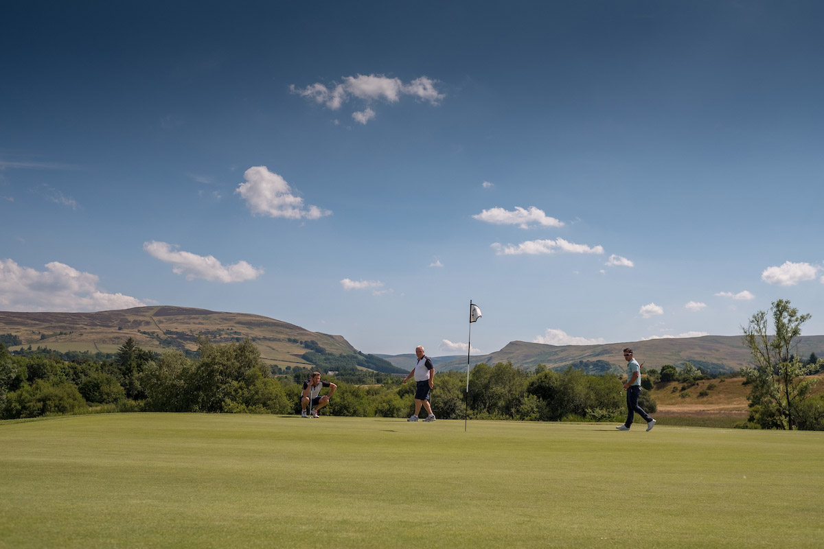 Golfers putting on course at Gleneagles