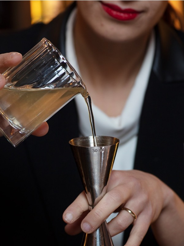 Lulu Fedi pours alcohol in a measure