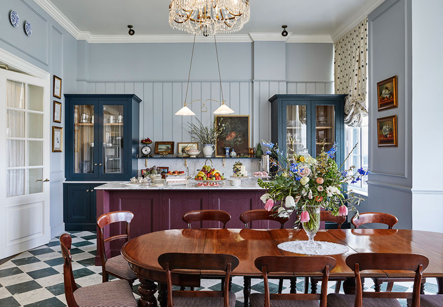 A large highly polished wooden table in front of a breakfast bar in the pantry at Gleneagles