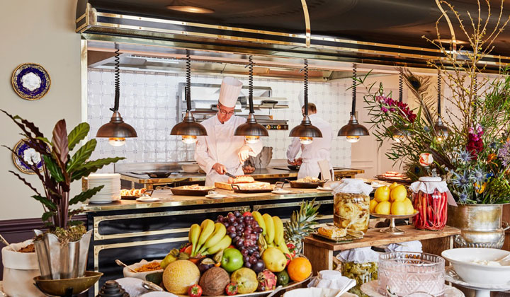 The Strathearn kitchen with a large selection of fruit laid out for breakfast