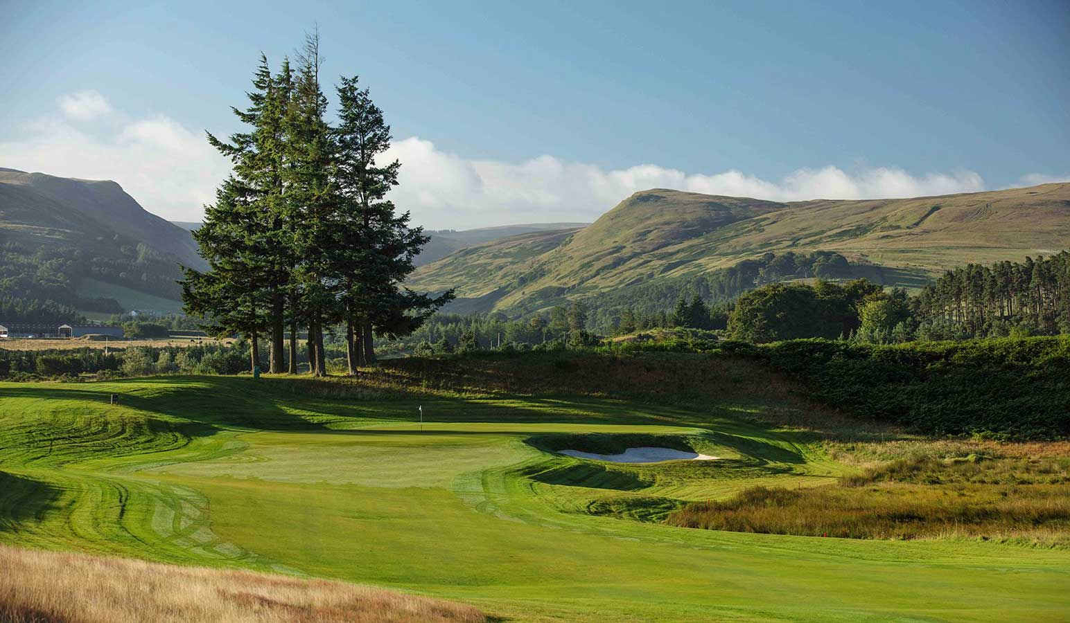 A view of the Gleneagles golf courses on an autumnal day with the Ochil Hills in the background