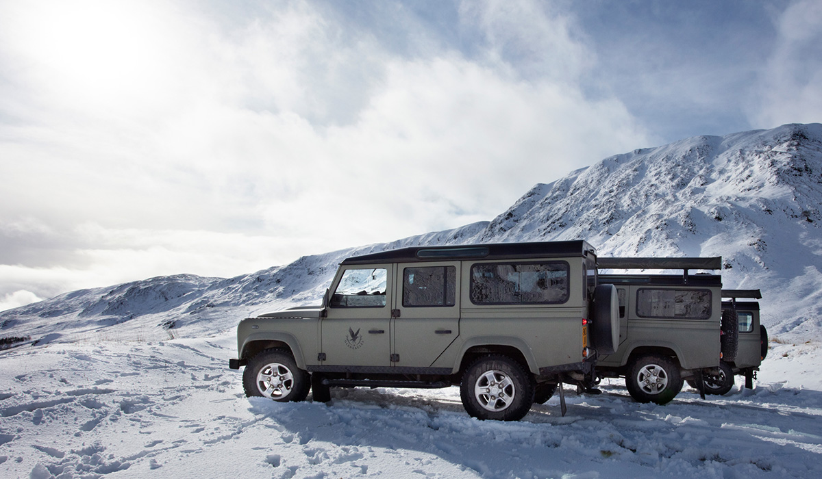 Land Rover defenders in the snow at Glen Artney near Gleneagles